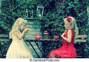 lovely kid drinking tea