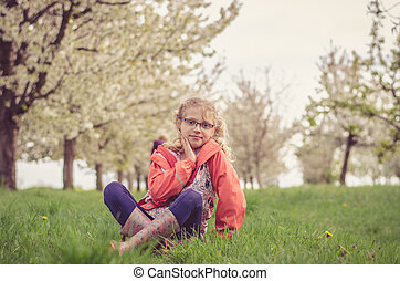 lovely kid in spring nature