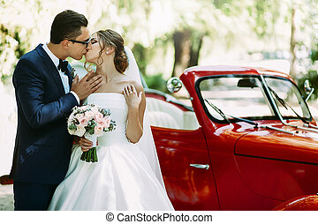 Lovely kiss of the couple on their wedding day