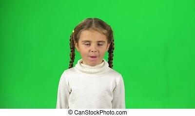 Lovely little female is feeling sick in the studio on green...