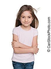 Lovely little girl against the white