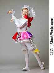 Lovely little girl dancing in colorful costume