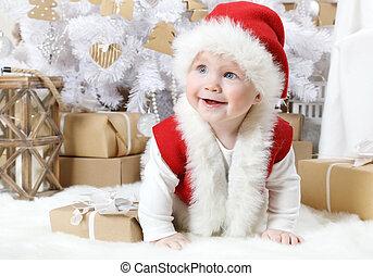 Lovely little girl dressed as Santa