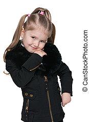 Lovely little girl in a black jacket