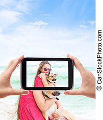 Lovely little girl is photographed with a dog on the coast