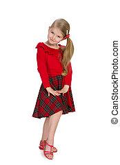 Lovely little girl stands