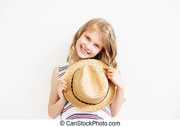 Lovely little girl with straw hat against a white background