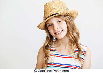 lovely little girl with straw hat on a white background