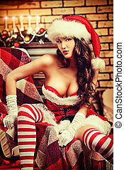 lovely maiden - Sexual young woman in Santa Claus costume...