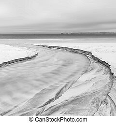 Lovely minimalist landscape black and white image of empty beach at low tide