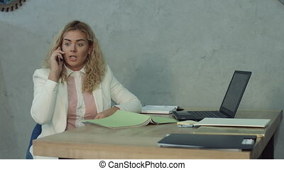 Lovely office woman awakened by phone call and answer