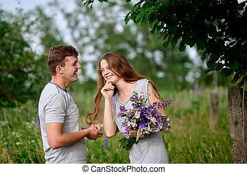 lovely portrait of a happy couple outdoors in meadow