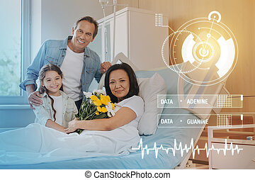 Lovely portrait of a smiling family in a modern hospital