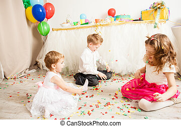 lovely pretty kids are playing on the floor