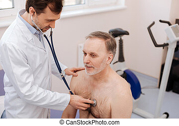 Lovely prominent private doctor checking patients breathing...