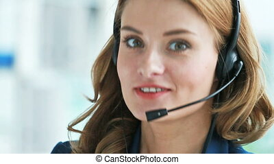 Charming girl consulting clients by the phone or online, good for ads and commercials