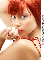 redhead with red beads looking over shoulder - lovely...