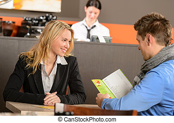Lovely romantic couple dating in bar ready to order