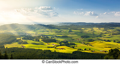 Lovely rural countryside in beautiful sunlight. Pasture landscape with barnyards.