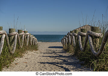 Lovely Sandy Walkway To The Ocean On A Summers Day