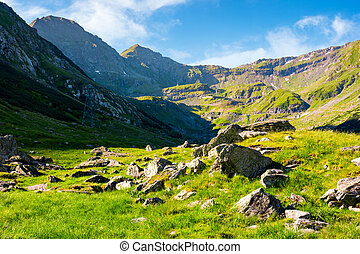 lovely scenery of Transfagarasan road in valley. rocks on...