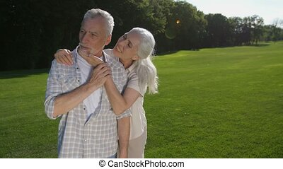 Lovely senior woman whispering husband about love - Portrait...