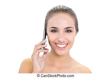 Lovely smiling brunette woman using a mobile phone