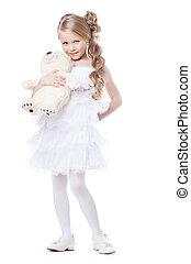 Lovely smiling girl with white teddy bear
