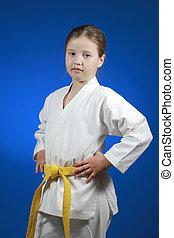 Lovely sportswoman in karategi