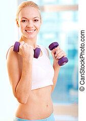 Lovely sportswoman - Vertical portrait of a positive female ...