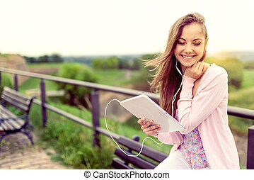 Lovely student girl with tablet
