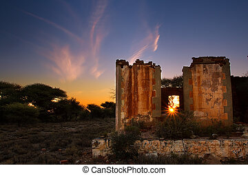 Lovely sunset in Kalahari with old house