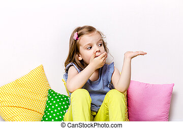 Lovely surprised girl covering mouth with hand