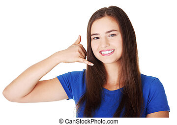 "Lovely teen woman gesturing ""call me"""