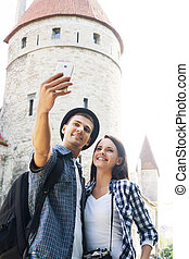Lovely tourist couple taking a selfie