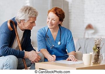 Lovely trained nurse explaining specifics of her work