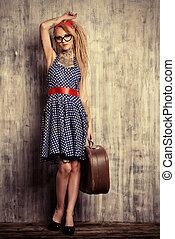 lovely traveler - Modern pin-up girl in old-fashioned polka-...