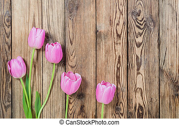 Lovely tulip flowers on wooden table, rustic design