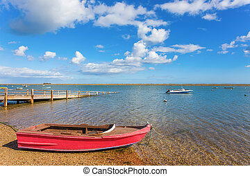 Lovely view of the river, the lake with a boat on the water. Summer.