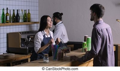 Lovely waitress taking order from customer at cafe -...