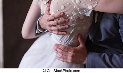 Lovely wedding couple embracing