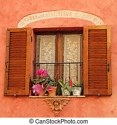 lovely window with angelic decor and flowers on windowsill