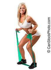 Lovely woman doing fitness exercises with rubber band. Isolated white background