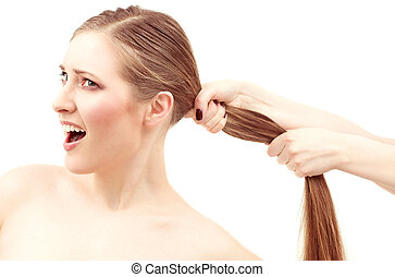 pull - lovely woman face and female hands pulling her hair