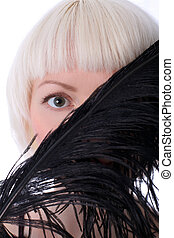 lovely woman hiding face of black feather isolated on white