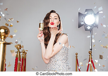 Lovely woman holding glass of champagne
