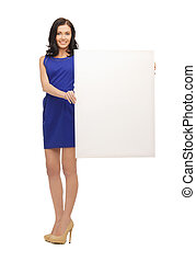 lovely woman in blue dress with blank board - picture of...