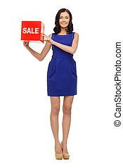 lovely woman in blue dress with sale sign
