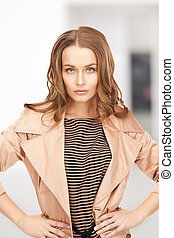 lovely woman in coat - bright picture of lovely woman in...