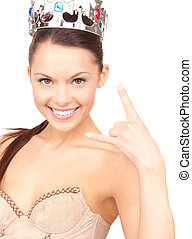 woman in crown showing devil horns gesture - lovely woman in...